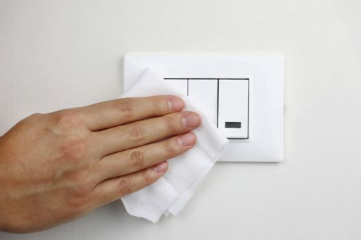 COVID-19 Pandemic Coronavirus Woman Hand Disinfect Light Switches with Wet Wipes Alcohol Cleaning Against Coronavirus Disease 2019 Outbreak Contamination Prevention