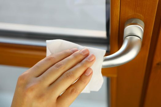 COVID-19 Pandemic Coronavirus Woman Hand Disinfect Doorknob Handle with Wet Wipes Alcohol Cleaning Against Coronavirus Disease 2019 Outbreak Contamination Prevention