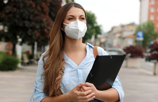 COVID-19 Global Economic Crisis Unemployed Worried Girl with Mask Looking for Job Walking in City Street Delivering Curriculum Vitae