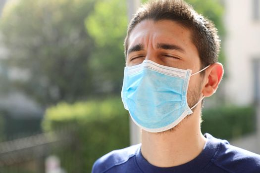 COVID-19 Pandemic Coronavirus Close up of man with surgical mask breathing outdoor