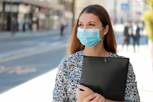 COVID-19 Global Economic Crisis Unemployed Girl Medical Mask Looking for a Job Walking in City Street Delivering Curriculum Vitae