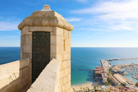Santa Barbara castle tower with aerial view of Alicante famous touristic city in Costa Blanca, Spain