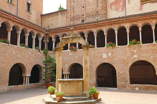 BOLOGNA, ITALY - JULY 22, 2019: cloisters in the inner courtyard of Santo Stefano church in Bologna, Italy