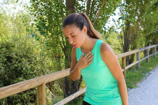 Running nausea. Nauseous and sick ill runner vomiting. Running woman feeling bad about to throw up. Girl having nausea from dehydration or chest pain.