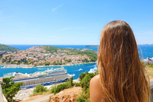 Travels in the Mediterranean. Young woman enjoying Croatia coast view from Dubrovnik city. Summer holidays in Europe.