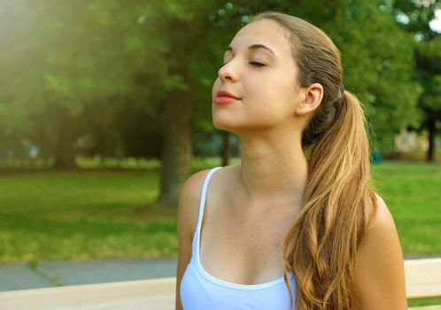 Portrait of a woman relaxing breathing fresh air in the park.