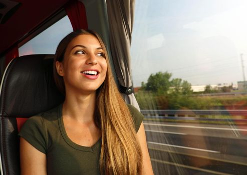 Happy cheerful smiling woman enjoying her travel on bus. Concept public transportation commuter.