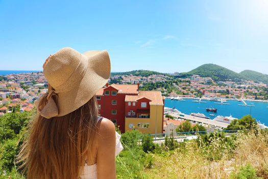 Europe travel woman looking at Dubrovnik town from viewpoint, Croatia, Europe