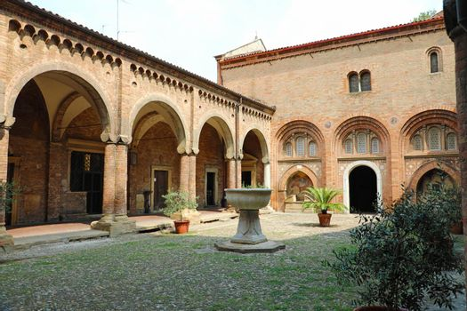 BOLOGNA, ITALY - JULY 22, 2019: Image of cloisters in the inner courtyard of Santo Stefano church in Bologna, Italy