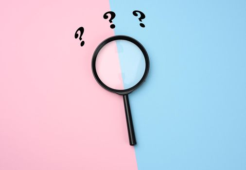 black magnifier on a pink-blue background and question marks. The concept of uncertainty and the search for solutions, doubts