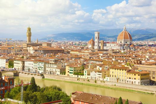 Panoramic view of the city of Florence with river Arno, Palazzo Vecchio palace and Cathedral of Santa Maria del Fiore (Duomo), Florence, Tuscany, Italy.