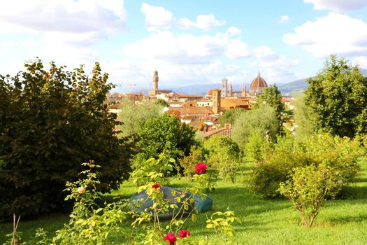 Glimpse view of Florence cityscape from park. Panoramic view of the city of Florence with Palazzo Vecchio palace and Cathedral of Santa Maria del Fiore (Duomo), Florence, Tuscany, Italy.