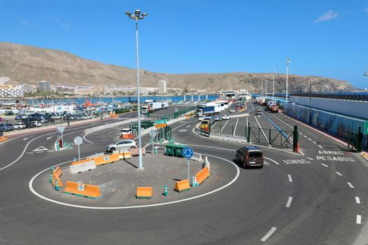 TENERIFE, SPAIN - MAY 28, 2019: traffic roundabout and road to port area of Los Cristianos, Tenerife.