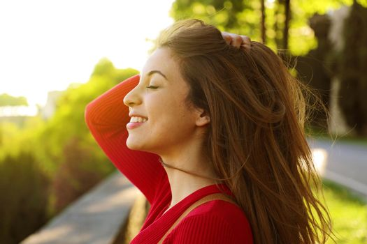 Young woman outdoors portrait with closed eyes