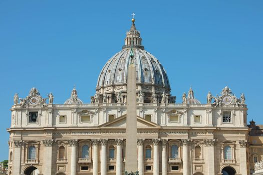 St. Peter Basilica with the dome and the Egyptian obelisk in Rome, Italy.