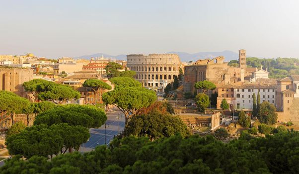 Panoramic view of Rome. Cityscape skyline of landmarks of Ancient Rome: Coliseum and Roman Forum famous travel destinations of Italy.