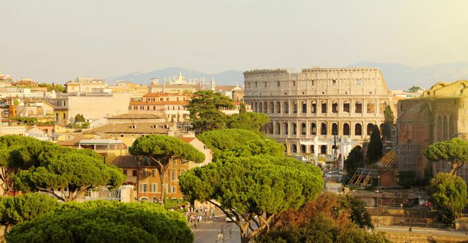 Rome cityscape skyline with landmarks of the Ancient Rome: Coliseum and Roman Forum famous travel destinations of Italy.