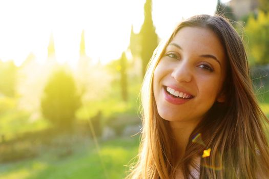 Outdoor atmospheric lifestyle photo of young beautiful lady. Warm spring. Warm autumn.