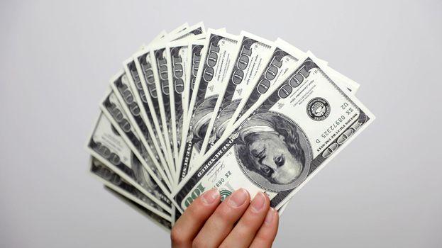 Dollars in hand. Fan of money.