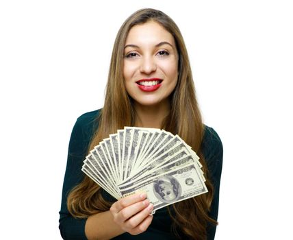 Image of young rich woman smiling with white teeth and holding lots of money in dollar currency isolated over white background