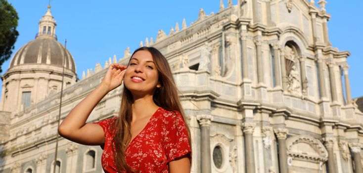 Smiling young woman visiting baroque Cathedral of Catania in Sicily. Summer holidays in Italy. Panoramic banner view.
