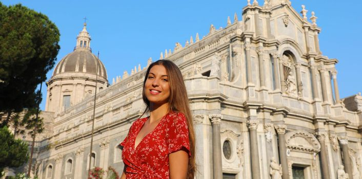 Beautiful woman visiting baroque Cathedral of Catania in Sicily. Summer holidays in Italy. Panoramic banner view.