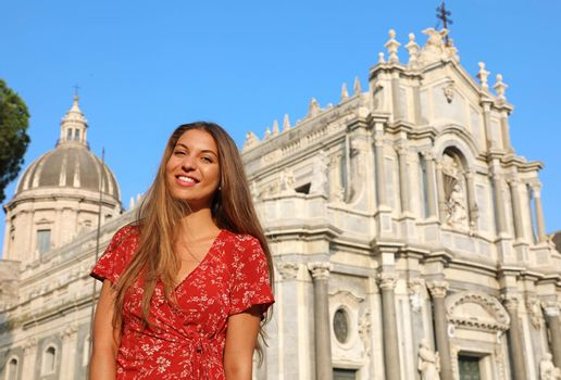 Attractive smiling woman visiting Sicily landmarks, Italy