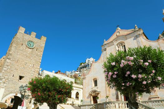 Taormina village with Clock Tower and San Giuseppe church in Sicily, Italy