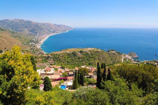 Beautiful landscape panorama of Sicily coastline. Blue Mediterranean sea and green mountians, Taormina, Sicily island, Italy.