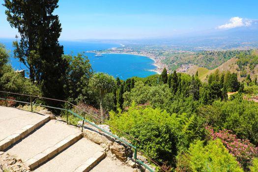 Beautiful aerial view of Sicily coastline. Blue Mediterranean sea and green mountians, Taormina, Sicily island, Italy.