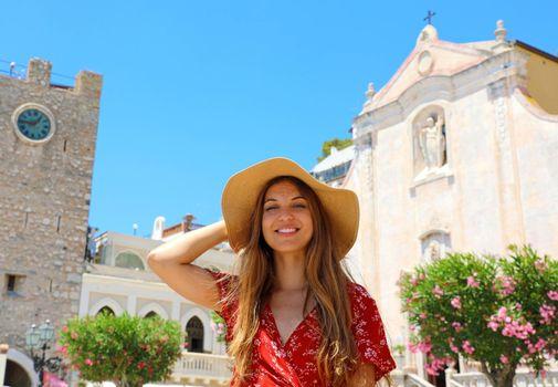 Beautiful smiling woman walking in Taormina village on Sicily Island, Italy