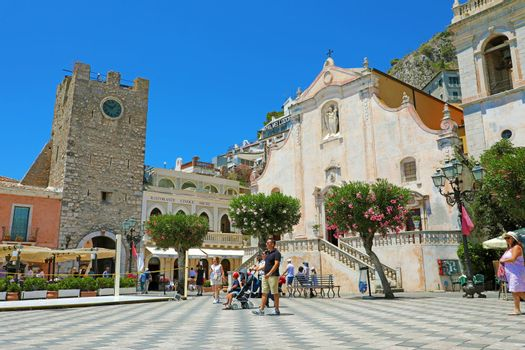 TAORMINA, ITALY - JUNE 20, 2019: Piazza IX Aprile square with tourists