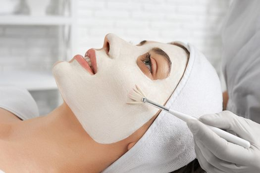 Young woman doing special procedure for improvements skin.
