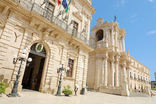SYRACUSE, ITALY - JUNE 22, 2019: The Town Hall and the Cathedral of Syracuse in Siciliy, Italy