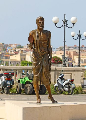 SYRACUSE, ITALY - JUNE 22, 2019: Bronze statue of Archimedes in Syracuse, Sicily