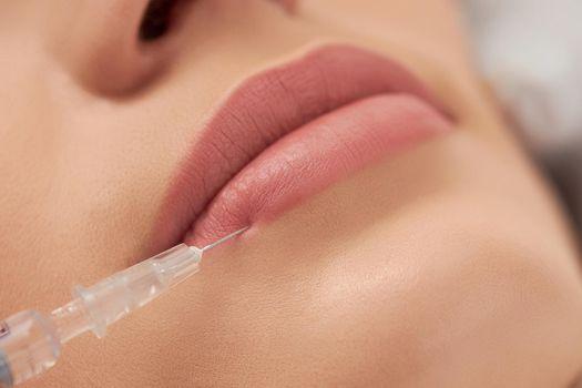 Procedure lip augmentation for young beautiful woman.