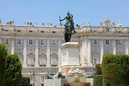 Monument to Philip IV of Spain with Royal Palace of Madrid on th