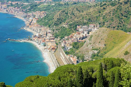 Aerial view of Sicily with Taormina and Giardini Naxos villages in Italy.