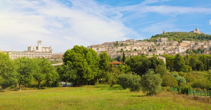 Panoramic view from countryside of the historic town of Assisi, Italy.