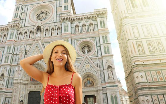 Portrait of beautiful tourist woman in Florence with Cathedral and Bell Tower on the background. Traveler girl in Italy with Florence landmark.