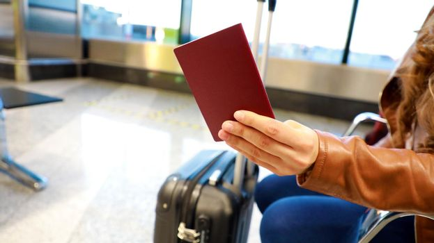 Passport in woman hand at airport
