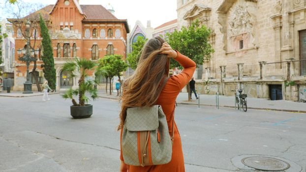 Travels in Europe. Young female backpacker visits the city of Valencia, Spain.