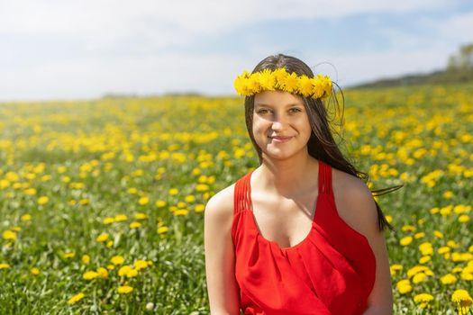 Young girl posing in dandelion meadow.