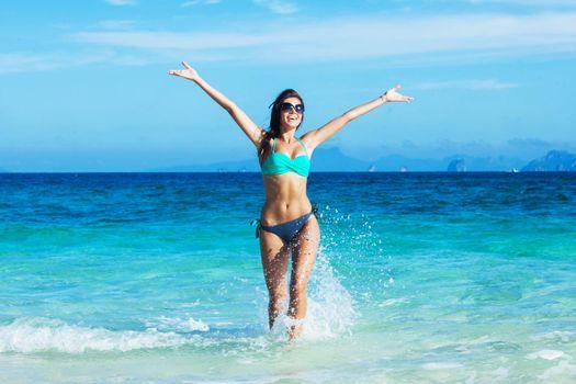 Happy woman splashing in sea