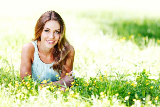 Woman relaxing on the green grass