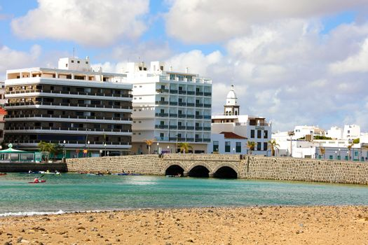 ARRECIFE, SPAIN - APRIL 20, 2018: Arrecife seafront with palm trees and buildings, Lanzarote, Spain