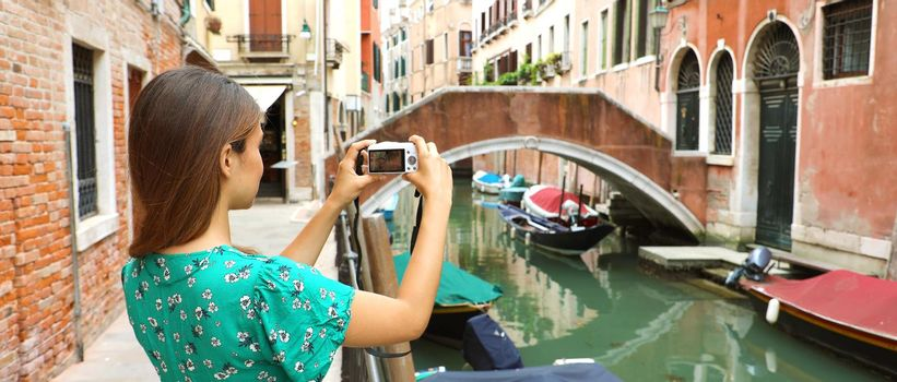 Woman taking picture in Venice banner panoramic view