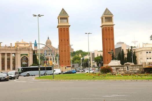 BARCELONA, SPAIN - JULY 13, 2018: Venetian towers in Placa d'Espanya square and National Art Museum on the background, Barcelona, Catalonia, Spain