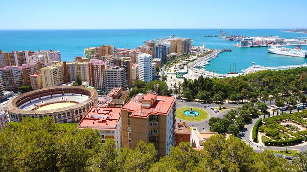 Panoramic banner view of Malaga City. Cityscape of Malaga with down town center with Mediterranean Sea port harbor and bullring from Gibralfaro viewpoint, Malaga, Andalusia, Spain.