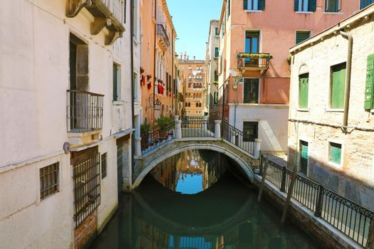 Picturesque  sight of channel with bridge in Venice, Italy